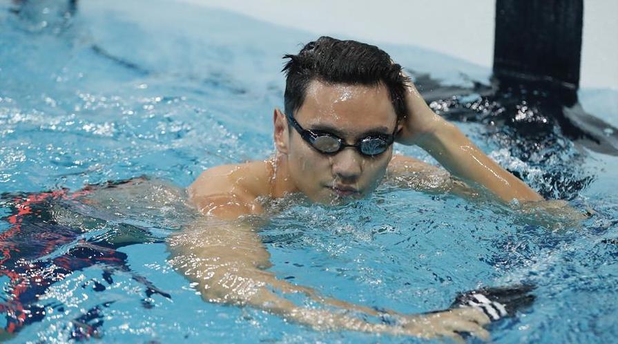 宁泽涛轻松晋级100米自决赛 与孙杨击掌互相鼓励